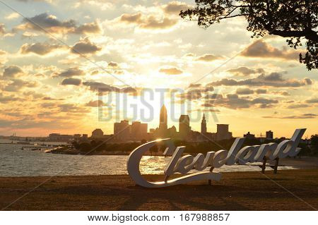 Sunrise over Cleveland sign and skyline at Lake Erie Edgewater park