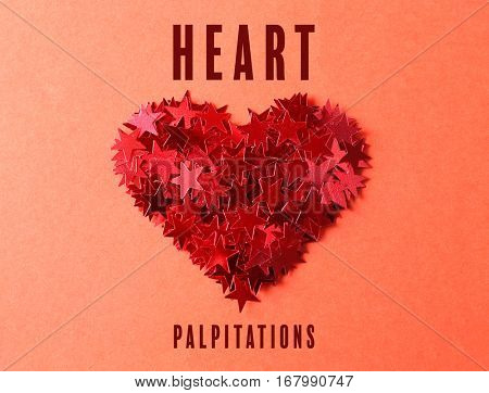 Cardiology and health care concept. Heart of bright confetti on color background