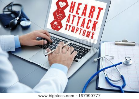 Cardiology and health care concept. Doctor working with laptop at hospital