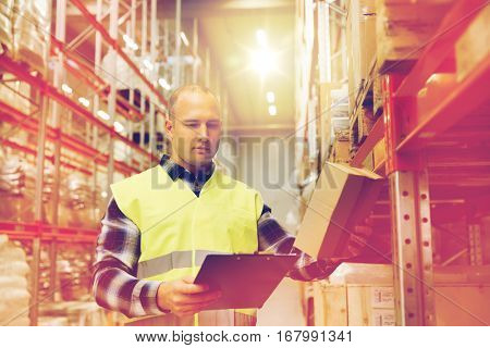 wholesale, logistic, people and export concept - man with clipboard and box in reflective safety vest at warehouse