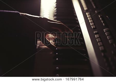 Playing on synthesizer keyboard in the dark