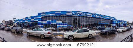 SIMFEROPOL CRIMEA UKRAINE - DEC 26 2016: Panoramic view to the passenger terminal of Simferopol international airport in Simferopol Ukraine on Dec 26 2016.