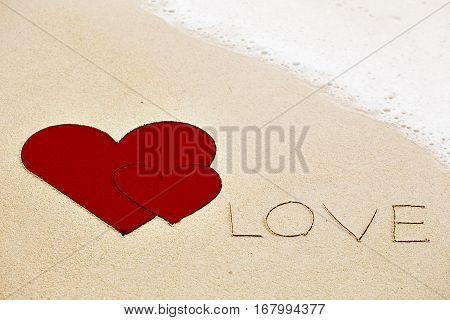 Inscription Of Love Written On Wet Yellow Beach Sand