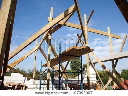 Building a new home with wooden rafters.