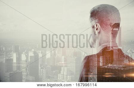 Back view of young businessperson looking into the distance on abstract city background. Research concept. Double exposure