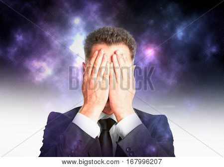 Businessman covering face with hands on abstract background. Risk and failure concept