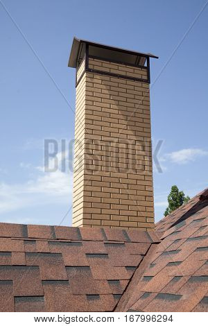 roof of a House with shingles and chimney
