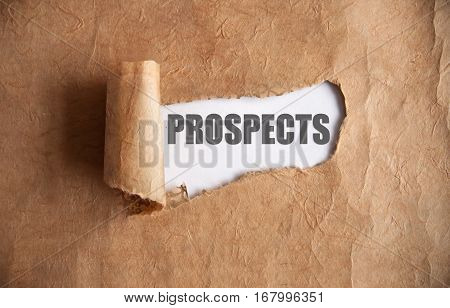 Torn piece of scroll uncovering prospects underneath