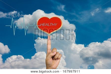 Red heart with pulse or heart beat and text healthy with hand on sky