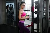 young fitness woman tired in gym drink sportive nutrition Amino Acid or bcaa of shaker horizontal photo poster