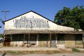Abandoned and decaying store building in Taft California poster