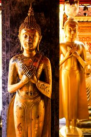 Two Buddha Statues, Contrasting Older One and Newer, in the Attitude of Peaceful. In Chiang Mai Thailand