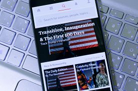 Hilton Head Island, SC, USA - January 31, 2017: The Headline in Flipboard App about President Trump's Transition in his Position