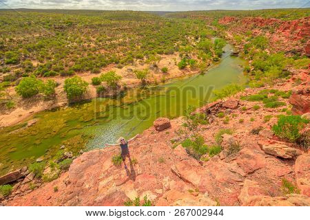 Blonde Caucasian Woman With Open Arms Enjoys In The Lower Part Of Murchison River In Kalbarri Nation