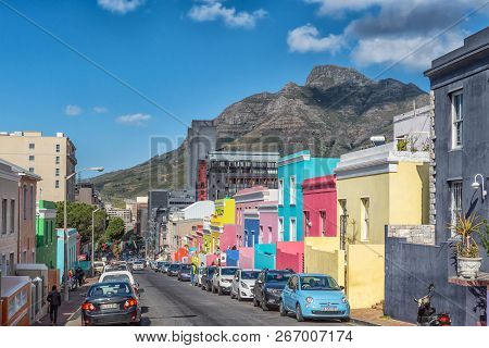 Cape Town, South Africa, August 17, 2018: A Street Scene, With Multi-colored Houses, People And Vehi