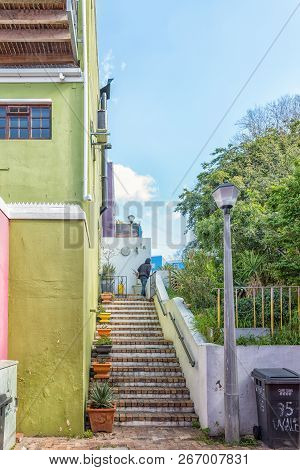 Cape Town, South Africa, August 17, 2018: A Street Scene, With Stairs Leading To Multi-colored House