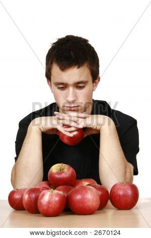 Young Man Eating An Red Apple