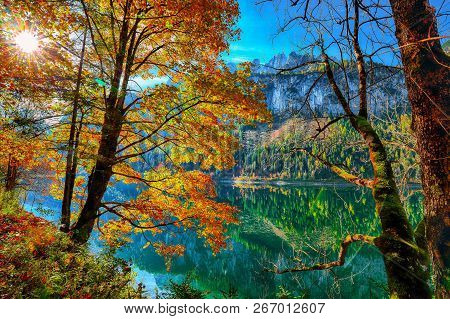 Beautiful View Of Idyllic Colorful Autumn Scenery With Dachstein Mountain Summit Reflecting In Cryst