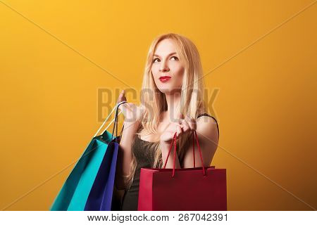 Happy Shopping Woman Holding Shopping Bags. Shopping, Sale, Gifts, Christmas, X-mas Concept. Amazed
