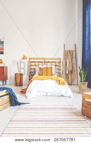 Bright Oldschool Teenager Bedroom With Vintage Furniture, Real Photo With Copy Space On The Wall