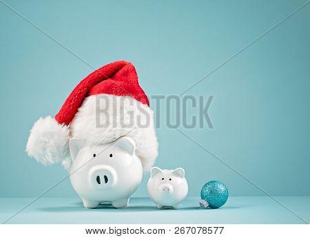 Piggy Bank Wearing Santa Hat - Saving Money For Christmas Concept
