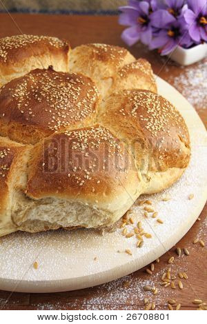 Fresh sesame bread over a wooden table