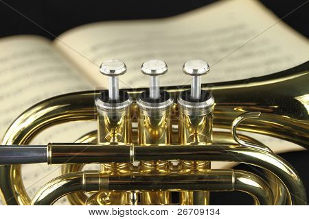 Trumpet with music sheet