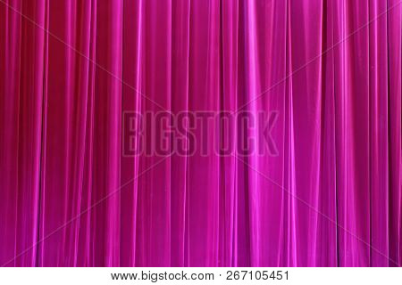 Photo Theatrical curtain of burgundy color of velvet. poster