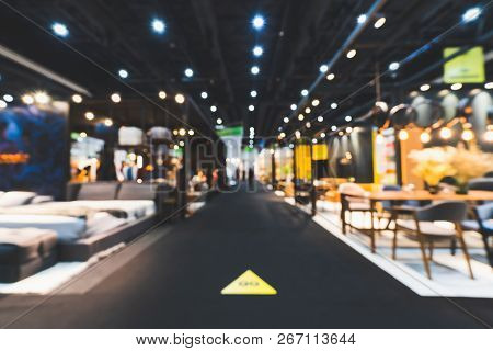 Blur, Defocused Background Of Public Exhibition Hall Holding Furniture Fair Event Or Business Trades