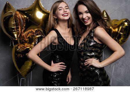 Party Fun. Beautiful Girls Celebrating New Year. Portrait Of Gorgeous Smiling Young Women Enjoying P