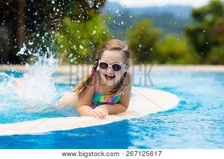 Child In Swimming Pool. Summer Vacation With Kids.