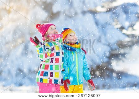 Kids Winter Snow Ball Fight. Children Play In Snow