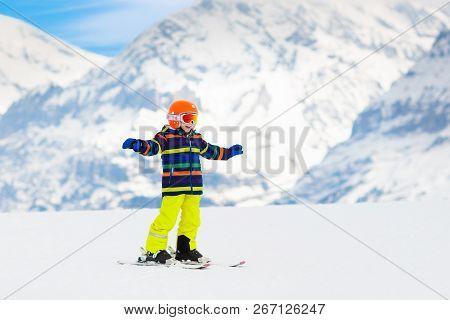 Kids Ski. Winter Family Snow Sport. Child Skiing
