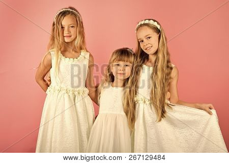 Group Of Happy Kids In Celebratory Clothes On Pink Background. Holidays, Christmas, New Year, Weddin