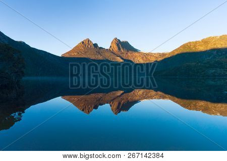 Beautiful Mountain Landscape Reflected In Mirror Smooth Lake Water In The Morning. Cradle Mountain,