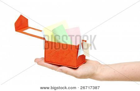 red box with color sticky notes on women hand isolated on white