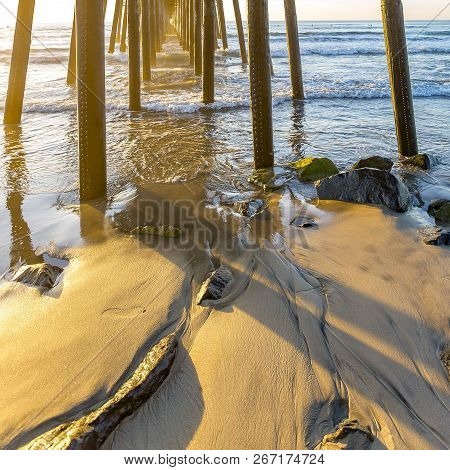 The Wooden Oceanside Pier In California At Sunset