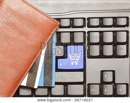 Keyboard computer button shopping cart. Online shop.