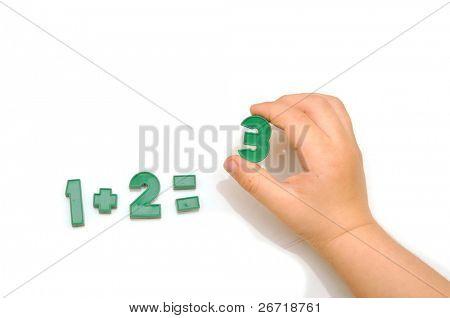 number fridge magnets, hand holding the number 3