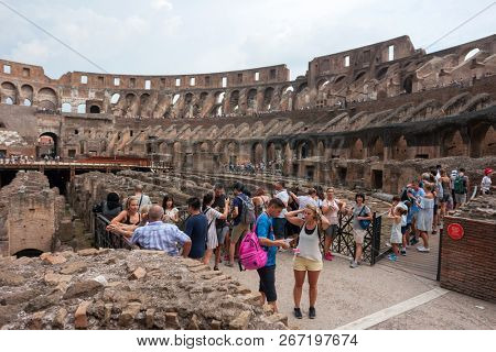 ROME, ITALY - AUGUST 3, 2018: Tourist visit inside of Rome Colosseum in Italy. The Colosseum was built in the time of Ancient Rome. It is one of most popular tourist attractions in Rome, Italy.