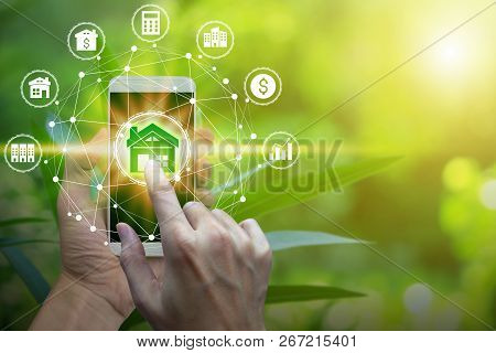 Hand Use Smartphone With Property Investment Icons Over The Network Connection On Property Backgroun