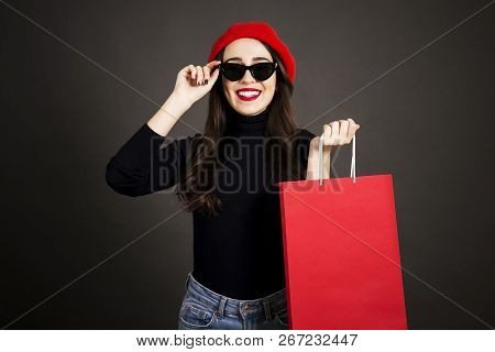 Beautiful Hipster Young Woman With Bright Red Lipstick Makeup, Wearing Black Turtleneck, Mom Jeans &