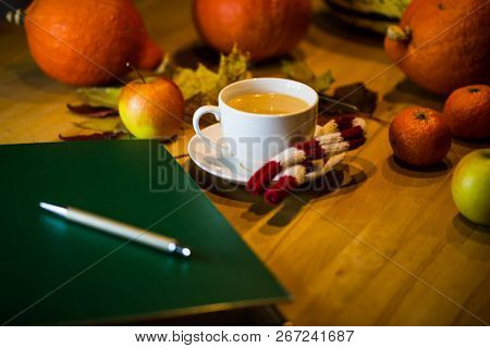 Coffee Cup With Folder, In The Background Pumpkin, Apples, Autumn Impression