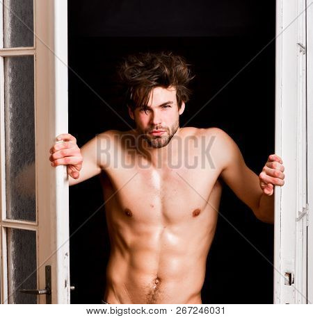 Sexy Attractive Macho Tousled Hair Coming Out Through Bedroom Door. Sexy Bachelor Lover Concept. Guy