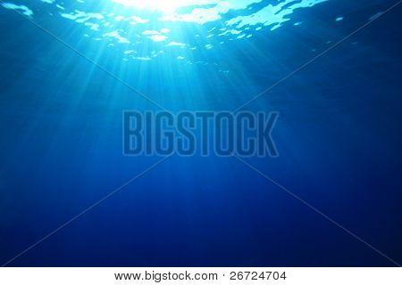 Sun rays in the blue ocean