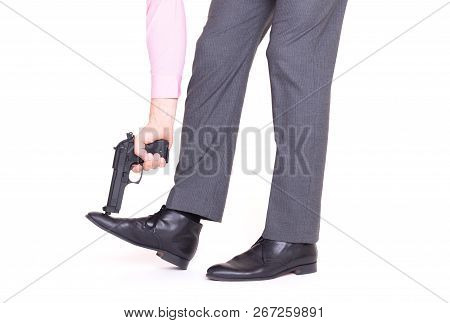 Businessman Shooting Himself In The Foot With A Handgun
