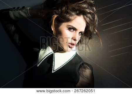 Her Perfect Style. Elegant Girl With Curly Hair. Fashion Woman With Makeup In Retro Style. Beauty An