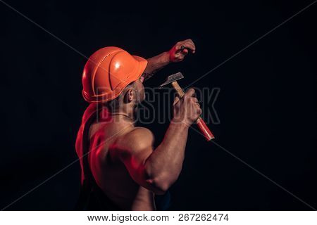 Under Construction, Coming Soon. Construction Worker Hammer A Nail. Man Work With Hammer. Hard Worke