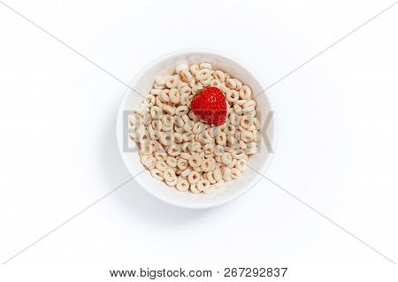 Oat Rings Cereal With Strawberry. Bowl Of Cereal With Berries On A White Background. Flat Lay, Top V