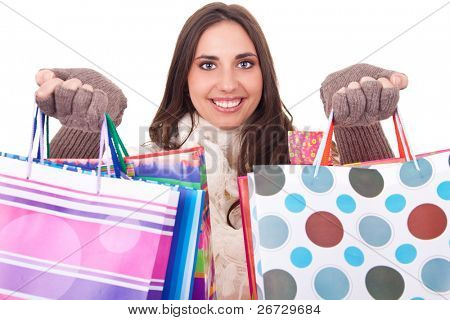 young smiling woman shoving her shopping bags, isolated on white background